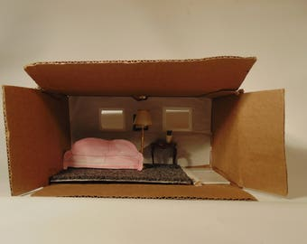 A red paper couch diorama