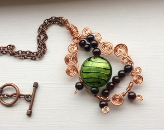 Copper Wire Wrapped Steampunk Teardrop Pendant filled with a Green Glass Striped Bead, Red Beads and Wire Spirals