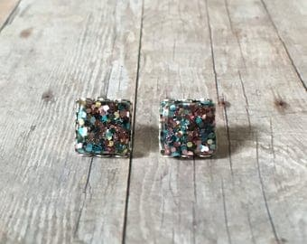 Nickel free!  Gorgeous aqua rose glitter studs