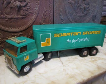 Vintage late 1970s era, 'Spartan Stores.' International, cab-over tractor trailer by 'ERTL!