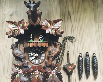 Authentic German Animated Cuckoo Clock - Black Forest Cuckoo Clock Hand Painted - It's a small world - Hunting Cuckoo clock