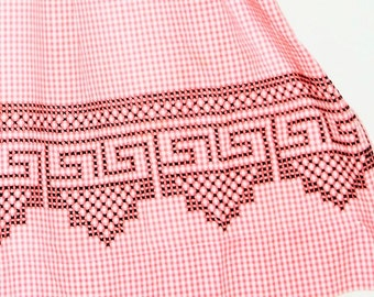 1950s pastel cross stitch embroidered half apron / pink gingham fabric with black trim / front pocket / kitschy kitchen /art deco design