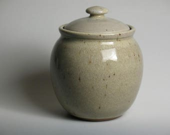 Lidded jar glazed in beige