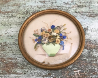 Vintage dry flowers bouquet In glass display frame.