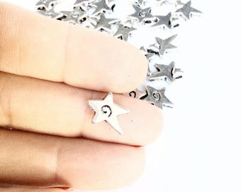 35pc tiny stars with swirls charms or beads antiqued silver color