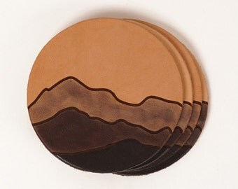 Leather drink coasters with mountain pattern detail | JIG