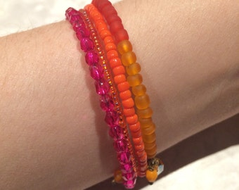 Brightly colored bracelet (pinks and oranges)