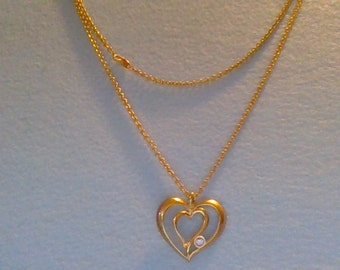 Avon long heart necklace