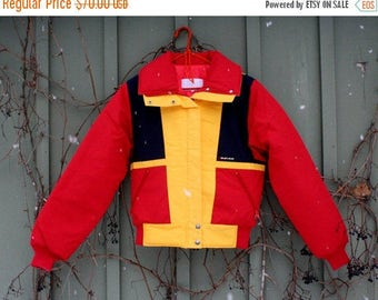 ON SALE 20% off vintage 1980s ski jacket Calgary Olympics Sun Ice red yellow and blue Holiday Gift Winter jacket Christmas gift