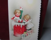 RESERVED 4 D Adorable 1950's christmas card 2 little angels carrying presents down a chimney with glitter accents