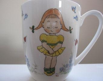 Hand painted mug of a young girl