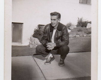 Man Wearing High Top Sneakers And Jeans Vintage Snapshot Mid Century Modern Photograph Black And White Photo Handsome Gentleman