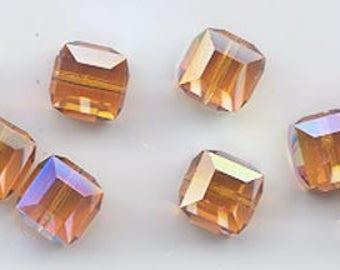 Twelve beautiful 8 mm Swarovski crystal cubes - art 5601 - 8 mm - topaz AB