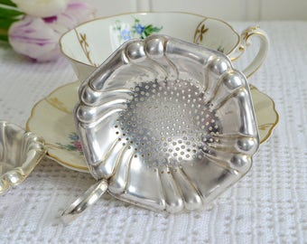 Two piece tea set , tea strainer with drip cup, vintage Swedish silver plate, tarnished and shabby, please view details