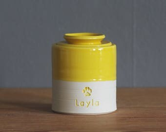 pet urn. lidded customized urn with name and stamp. urn for pet ashes or human cremains. yellow glaze on porcelain clay shown.
