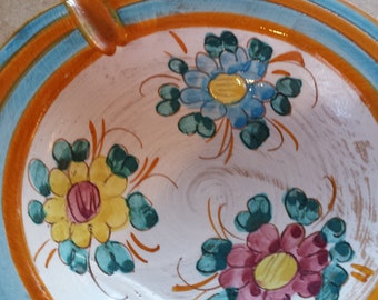 Vintage pottery ash tray Italy 1983 hand painted lovely flowers pretty colors.