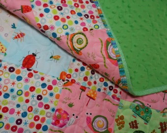 Modern baby quilt with a soft green minky back, baby girl blanket, stroller quilt, creatures and critters handmade quilt