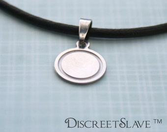 Stainless steel slave pendant. Non gender specific. Non-binary. For slaves, submissives and owned persons in a BDSM relationship