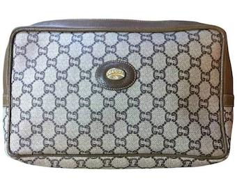 80's vintage Gucci Plus beige monogram large size makeup case, toiletry pouch, purse with golden logo plate. Unisex use