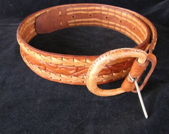 vintage golden brown leather belt with fancy lacing and leather covered buckle