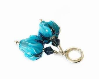 Blue rose bud lampwork bead earrings with dark blue leaves. Beautiful Denim Blue Swarovski Crystals, Sterling Silver
