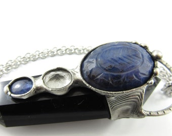 the high priestess - carved sapphire, tanzanite, faceted quartz & obsidian crystal pendant