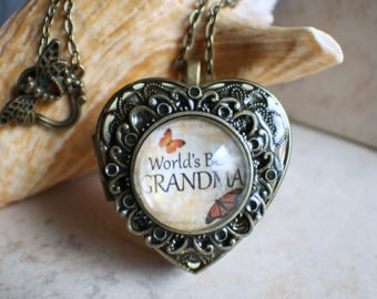 Music box locket for Grandma, heart music box locket with grandma image cabochon on front cover.