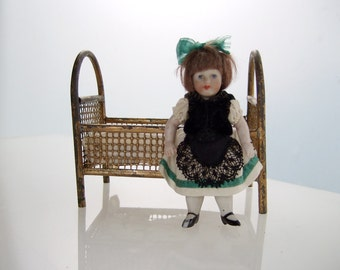 Antique German china doll house doll and metal wire bed | 1910s