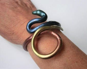 Rainbow snake bracelet/ painted with metal powder in rainbow colors / flexible Fimo (polymer) snake around the arm/ can bend open carefully