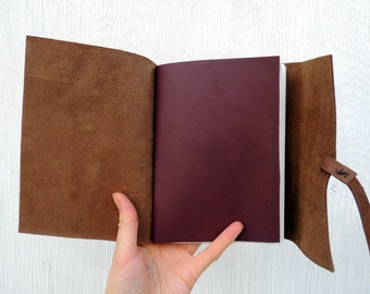 Personalized brown leather journal with purple cover page