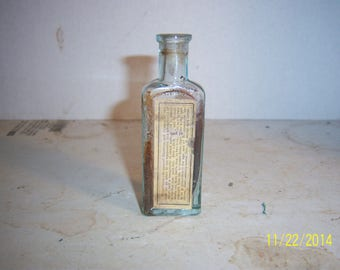 1880's  Dr Seth Arnold's Balsam Providence, RI 3 7/8 inch aqua medicine bottle with paper label No 1