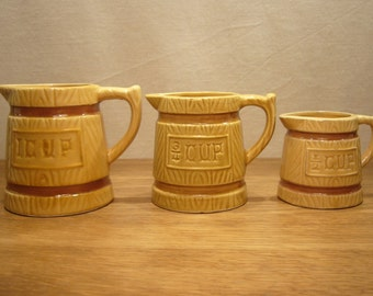 Vintage set of three ceramic measuring jugs, 1 cup, 3/4 cup and 1/2 cup
