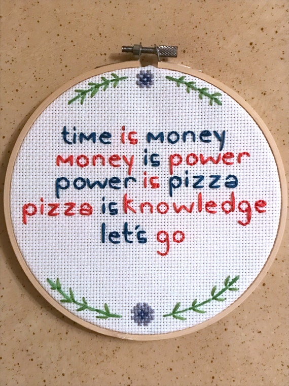 """Parks and Recreation Cross Stitch Quote """"Time is Money, Money is Power, Power is Pizza, Pizza is Knowledge"""" Embroidery Hoop Art"""