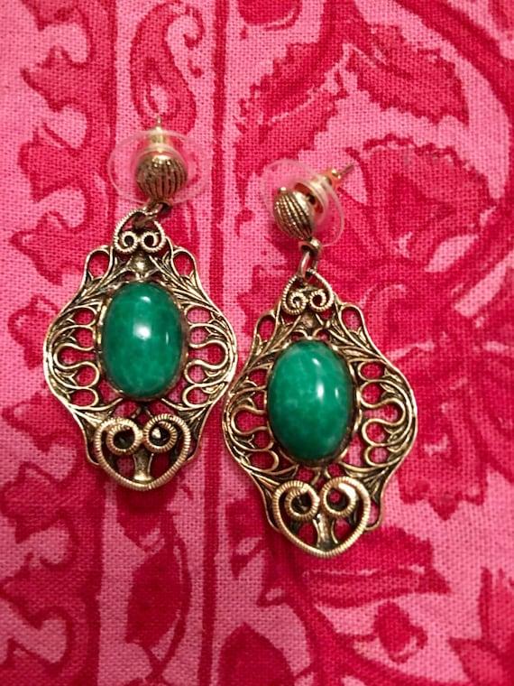 Asian inspired Green Stones on elegant golden scrolled dangling earrings