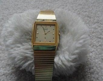 Goldtone Citizen Quartz Watch