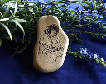 One Bat Mitzvah gift idea Rock with Jewish Girl reading Torah Scroll and wearing Tallit