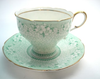 "Paragon "" Elegance "" Tea cup And Saucer, Green chintz tea cup, Double Warrant ParagonTea cup set."