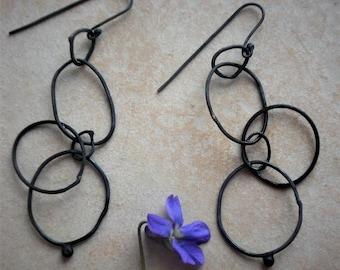 silver hoop loop earrings simple modern funky