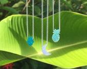 opal charm necklaces // hamsa, moon, pineapple, palm tree