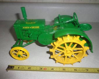 A nice diecast metal John Deere  farm toy tractor made in the USA