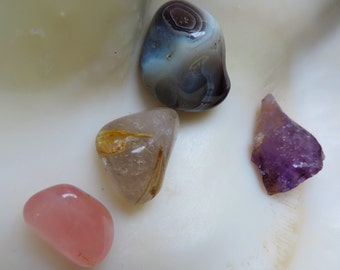Sample of minerals composed of 3 rolled stones and 1 rough Amethyst.