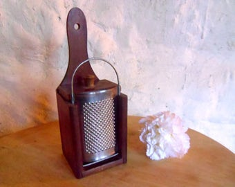 Vintage nutmeg grater or cheese grater. Tin grater and collection box with draw.