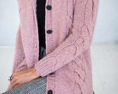 "Knitted cardigan worked in  in ""Puna"". Size: S - XXL."