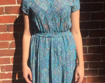1980s blue geo dress with pleated skirt