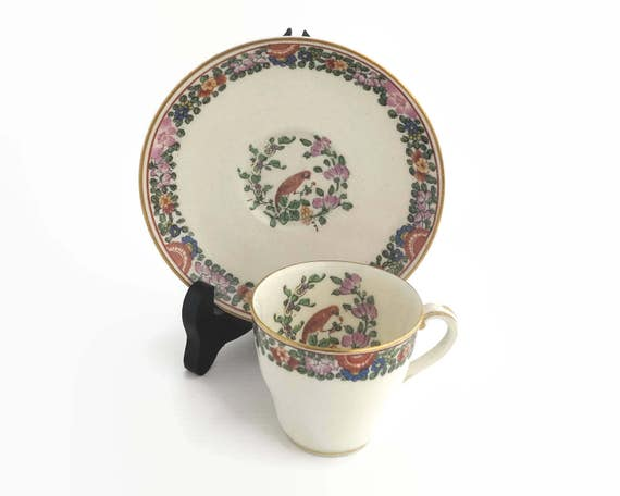 Royal Worcester antique demitasse cup and saucer with Old Worcester Parrot pattern, parrot and flowers, parrot inside cup, England, 1925