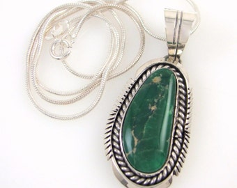 Sterling silver malachite necklace handmade by Navajo silversmith/jewelry designer Eugene Belone; 16 inch chain