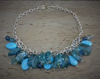 Statement necklace, mix of blue beads on silver plated chain, various shades and sizes of blue acrylic beads,glamorous necklace,fashionable