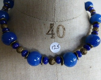 """Necklace of blue jade with """"antique bronze""""."""