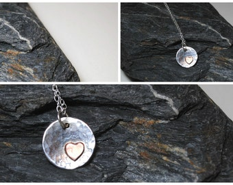 Sterling silver hammered disc with copper heart on sterling silver