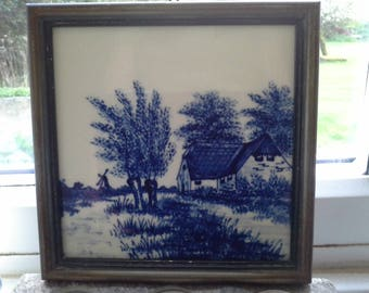 Hand-painted blue and white Dutch tile, framed